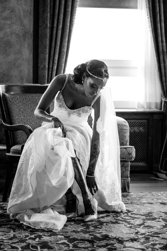 Banff Springs Wedding Photos Bride Putting On Shoes
