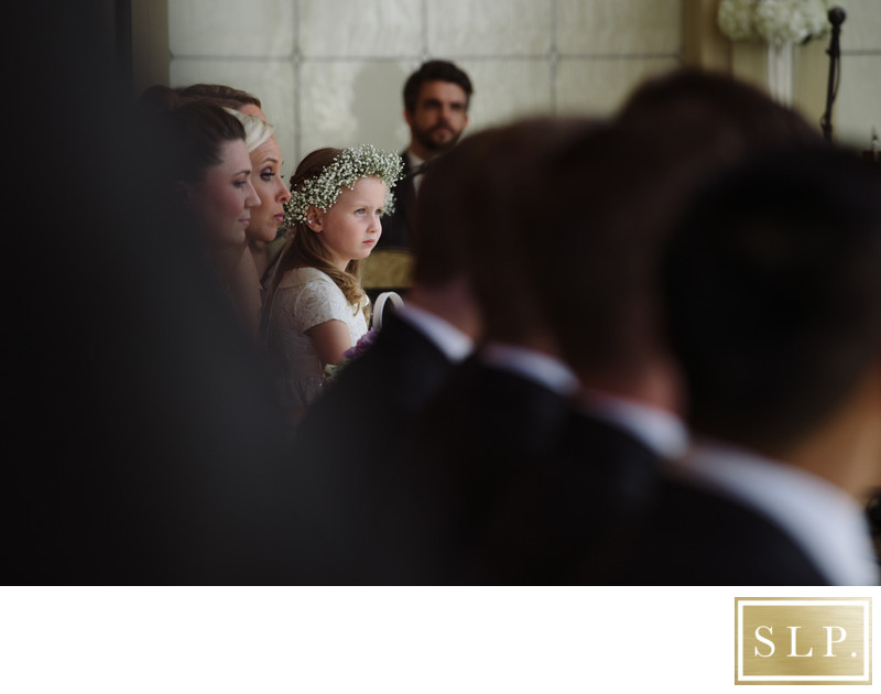 Flower girl watching ceremony