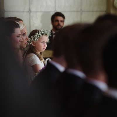 Flower girl watching ceremony