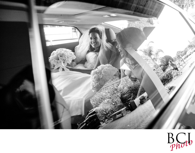 fun shot of the bride in her limo at the church