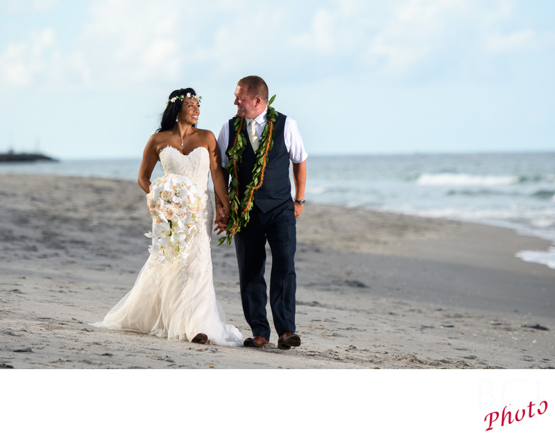 Bride and Groom stroll down the beach in Florida.