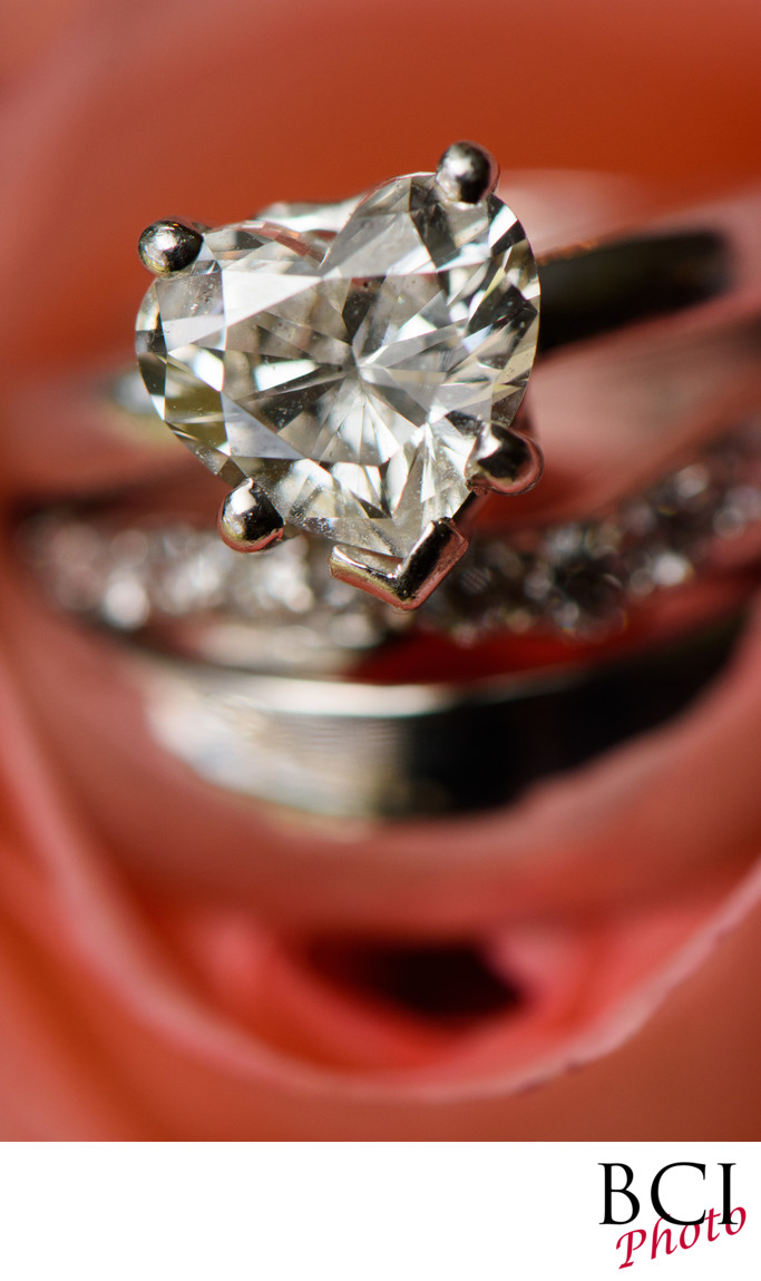 Wedding Ring Closeup with Heart Shaped Diamond Ring