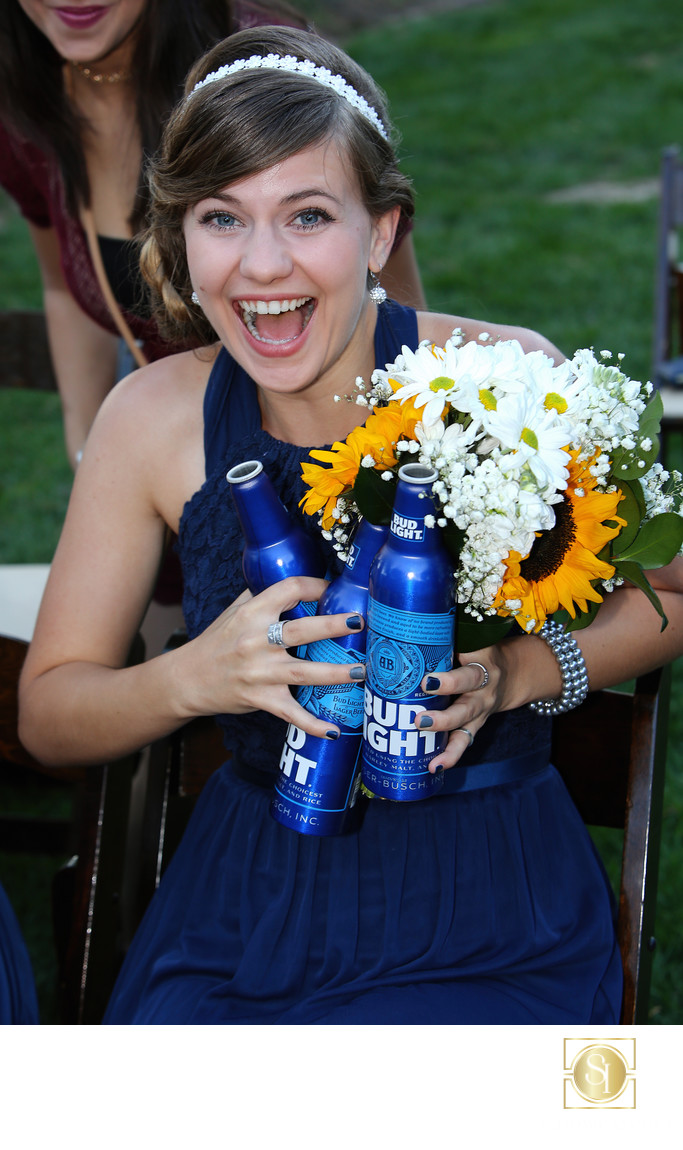 Fun candid photo of Bridesmaid with too many beers