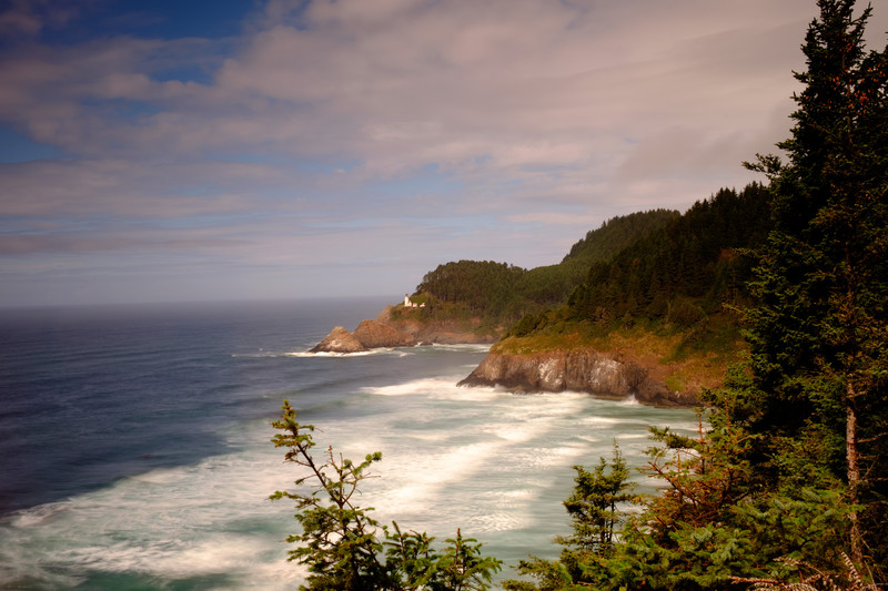 Scenic Vista of Heceta Beach Lighthouse rolling waves.