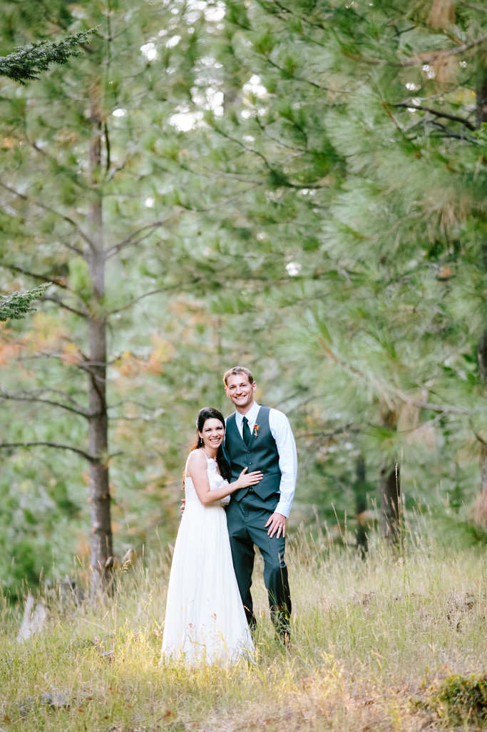 A beautiful and classic wedding photo in the woods.