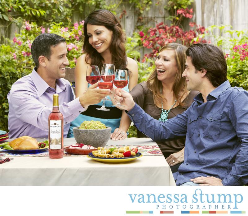 Lifestyle image of two couples enjoying wine.
