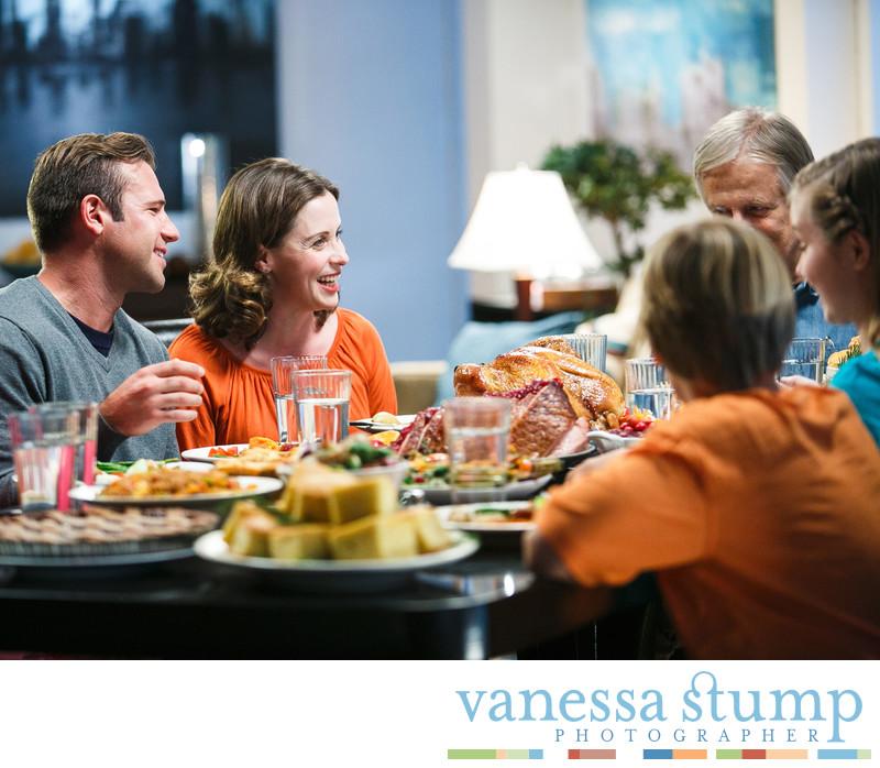 Extended family enjoying dinner