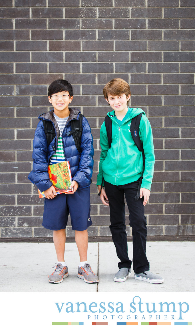 Outdoor portrait of two boys with backpacks
