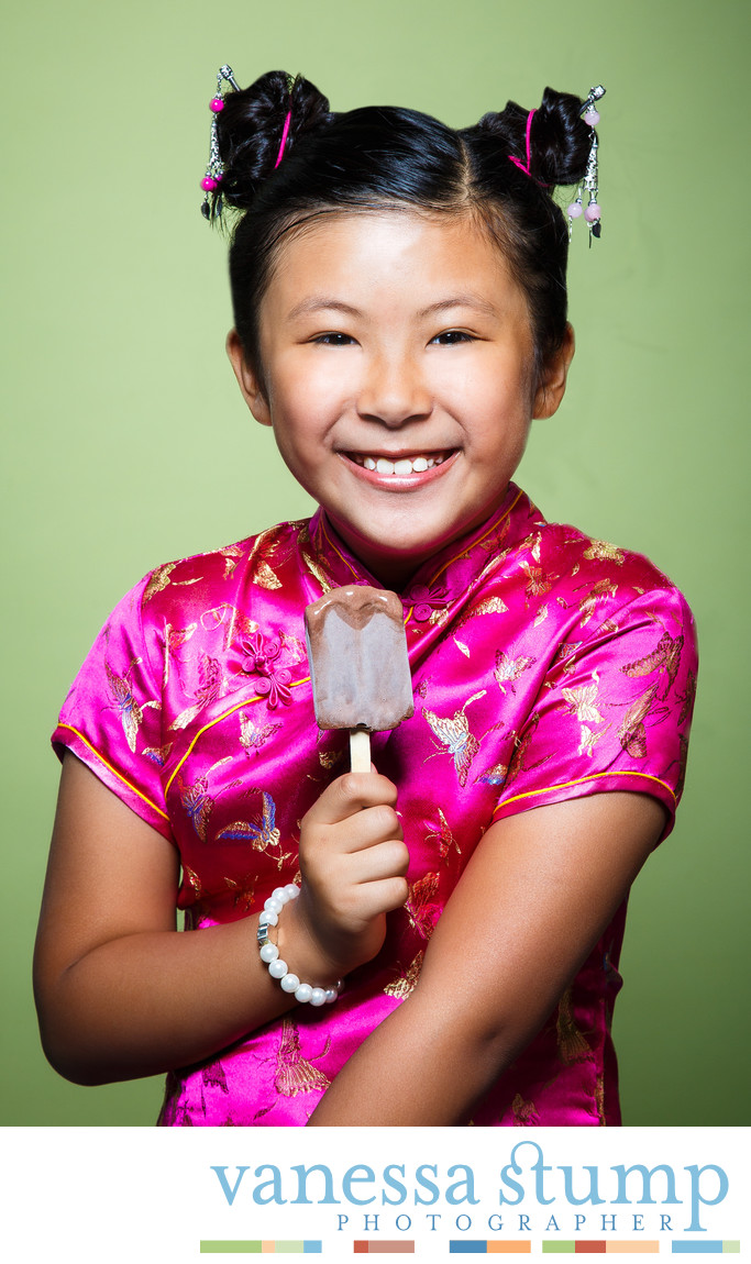 Smiling girl eating popsicle