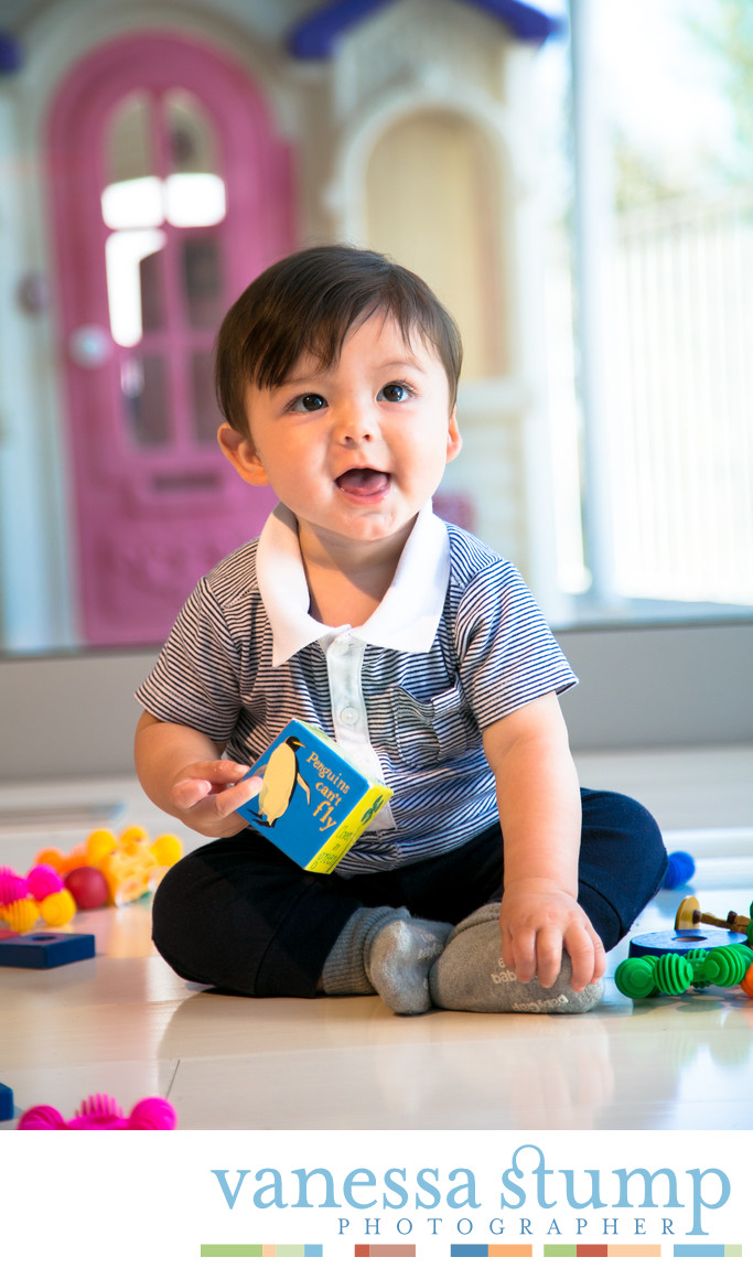 Adorable baby boy playing with toys