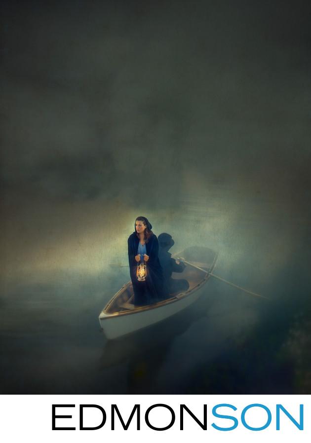 Woman With Lantern Rowing Through Fog