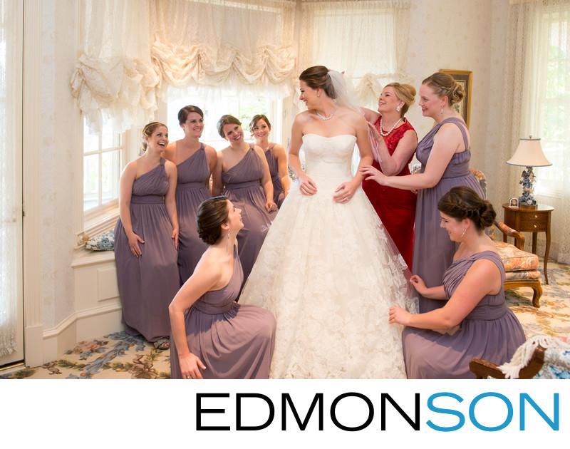 Loving Bridesmaids Fuss Over Brides Dress