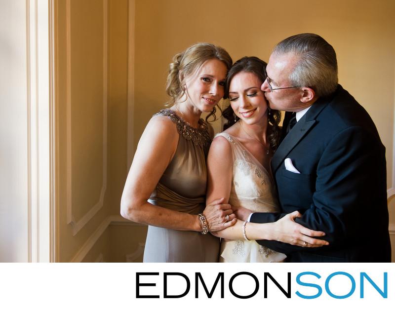Loving Parents Embraces Warwick Melrose Bride