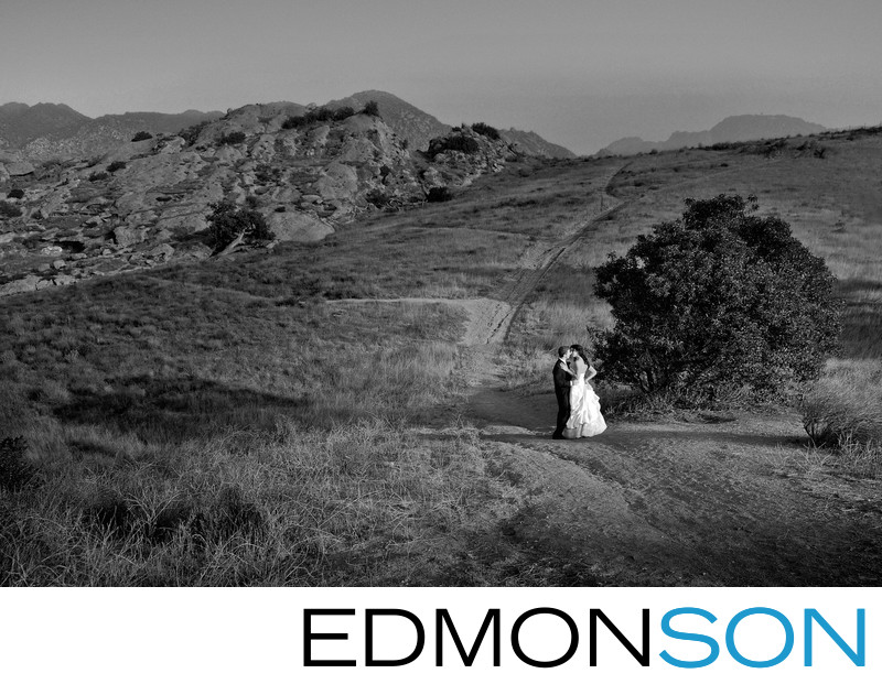 Couple Takes Outdoor Wedding Portraits At Sunset