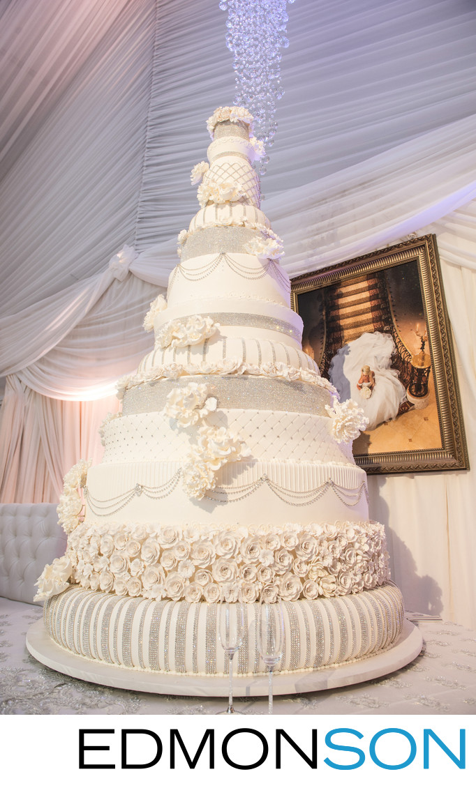 Grand Wedding Cake Towers Over Reception