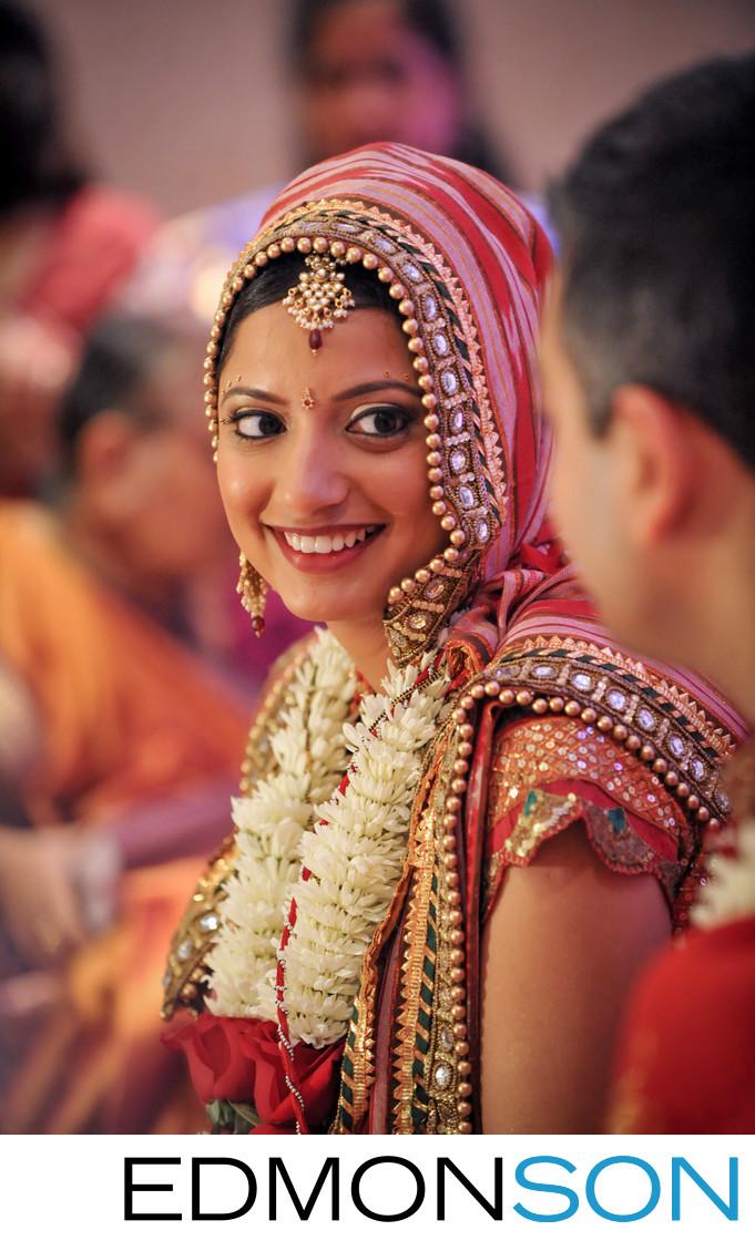 Houston South Asian Wedding Bride Smiles At Groom