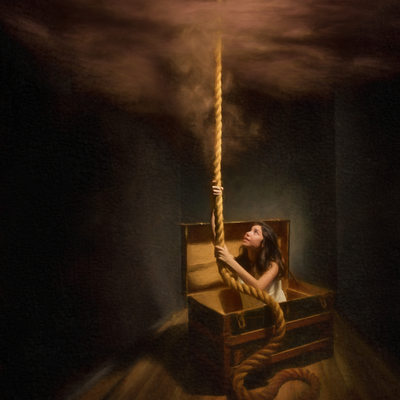 Young Woman Escaping Box Using Rope