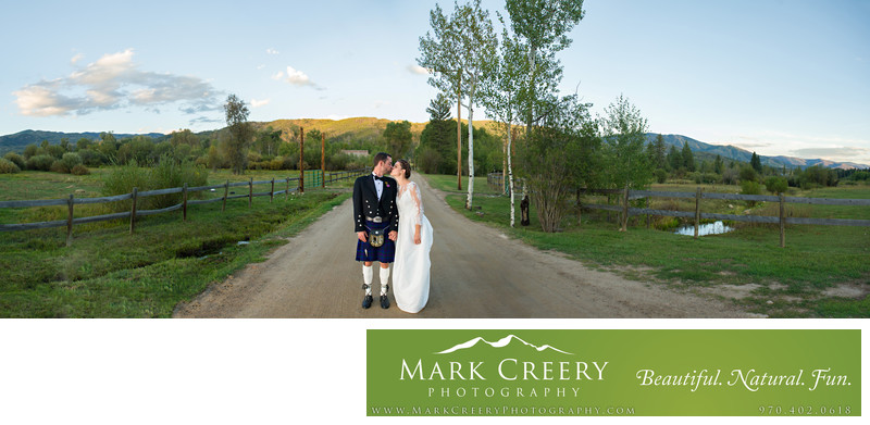 Bride & Groom kissing panorama at Perry Mansfield
