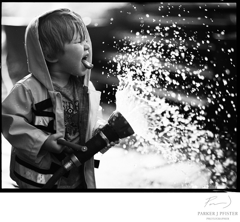 Boy with Fire Hose Portrait in Asheville