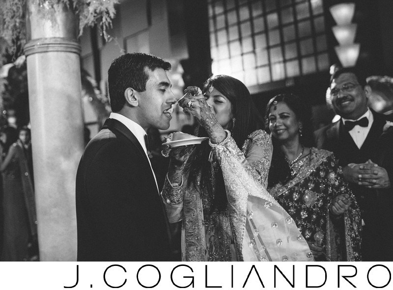 Feeding the Groom at South Asian Wedding at Cocomar