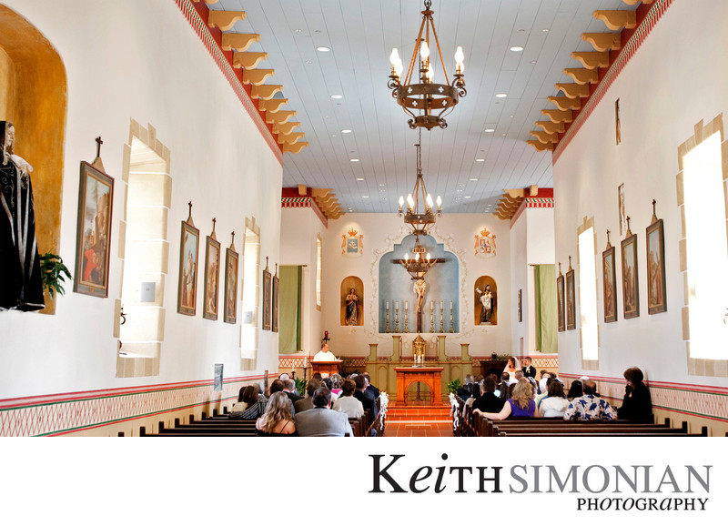 Wide angle view of guests and church during ceremony
