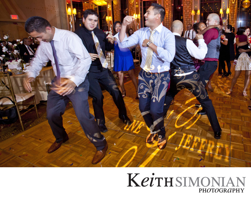 Dancing under the bride and grooms names at reception