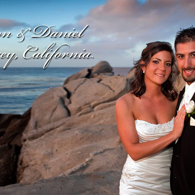 The happy couple standing by the Pacific Ocean