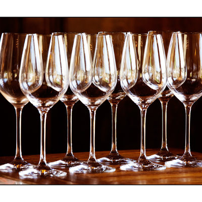 Eight empty Wine Glasses reflecting the light