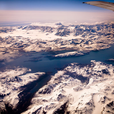 Snow Covered Mountains of Alaska seen from 32,000 Feet
