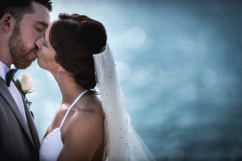 Bride and groom against lake