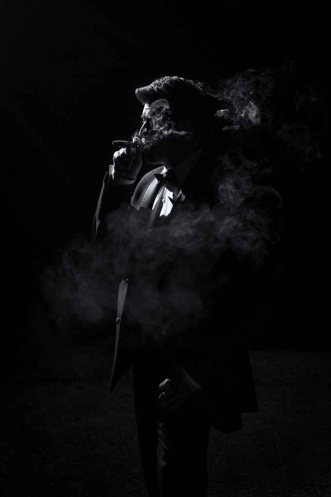 Groom smoking a cigar