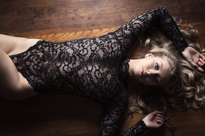 sexy lace outfit against hardwood floor