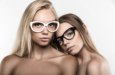 Two blondes wearing glasses