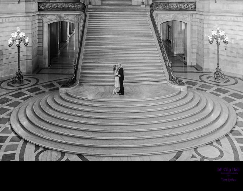 grand staircase wedding kiss