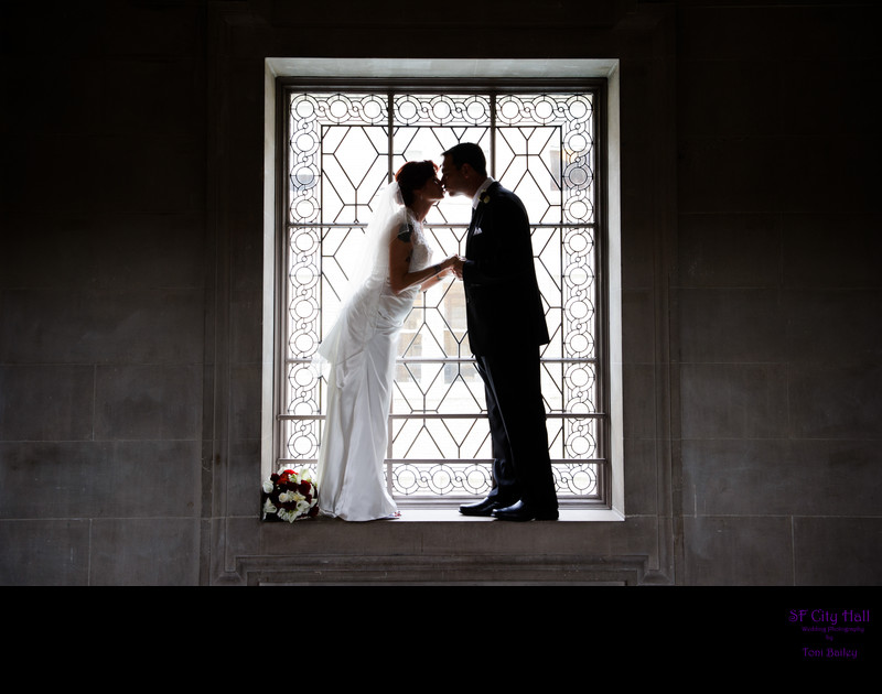 romantic kiss in window