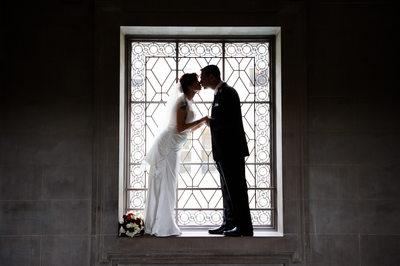 romantic kiss in window