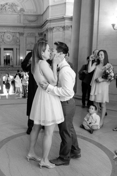 same sex wedding celebration kiss