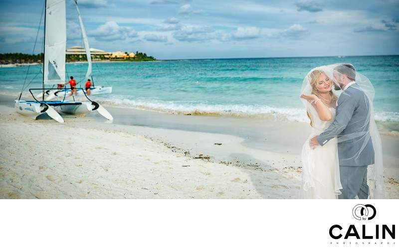 Newlyweds on the Beach at Barcelo Maya Palace Deluxe Wedding