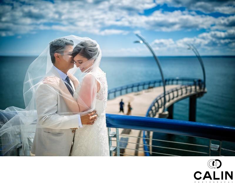 Bride and Groom Hugging at Brant Street Pier