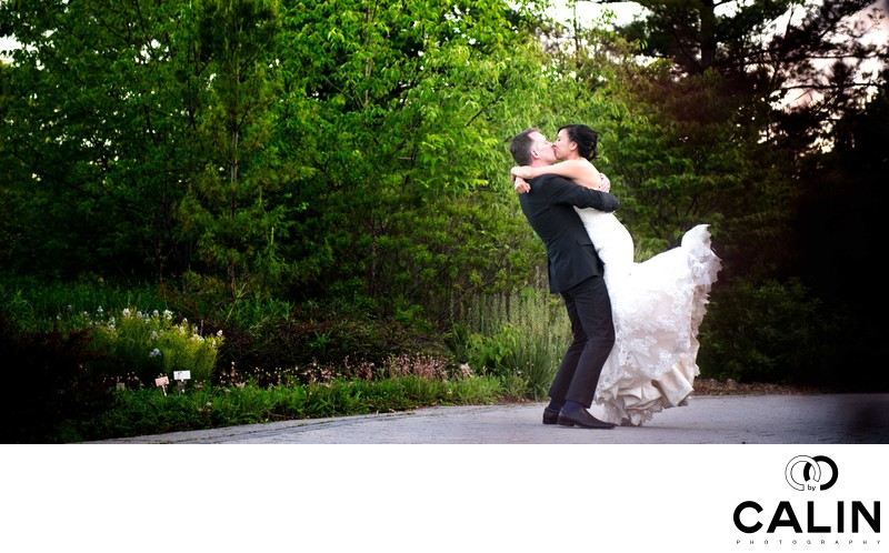 Groom Lifts Bride at Toronto Botanical Garden Wedding