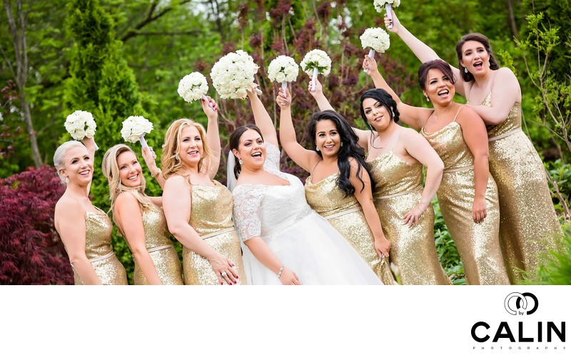 Bridesmaids Wave Their Bouquets