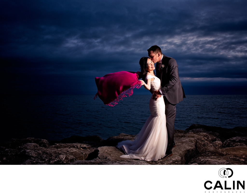 Bride with a Red Scarf and Groom on a Cliff