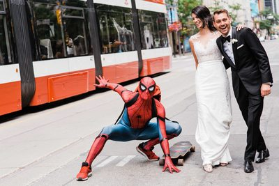 Spider-man Joins Bride and Groom at Storys Building Wedding