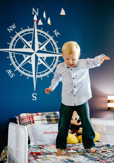 Fun and Colorful Child Portrait Jumping on the Bed!