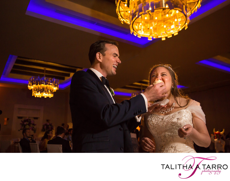 Sharing a cupcake during the wedding reception
