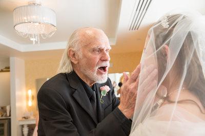 The bride's father seeing her for the first time