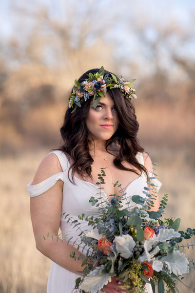 A boho bride with a flower crown and DIY bouquet