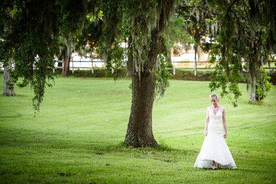 Bride Walks Through Field in Mississippi