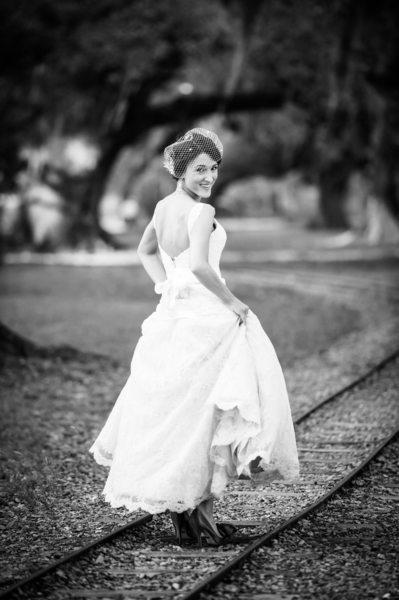 Bride on Railroad Tracks in City Park