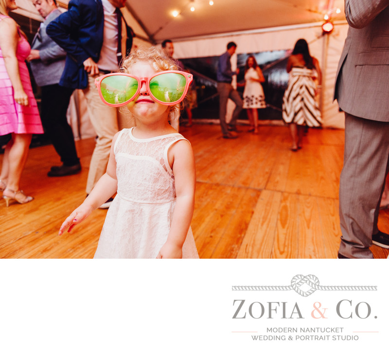 Funny flower girl at Galley Beach reception tent